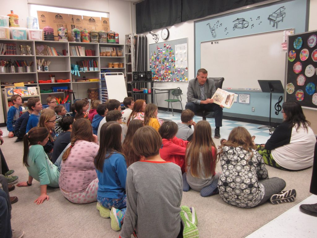 Deputy Minister Bram Strain reads at Elm Creek School